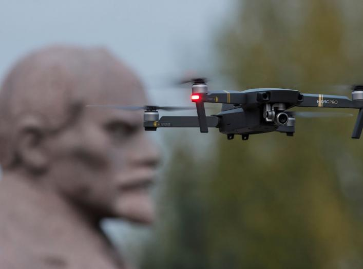A drone flies near a monument of Soviet state founder Vladimir Lenin at the Muzeon Arts Park in Moscow, Russia October 28, 2017. Picture taken October 28, 2017. REUTERS/Maxim Shemetov
