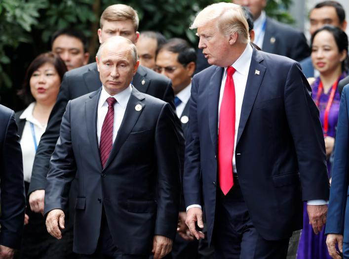 U.S. President Donald Trump and Russia's President Vladimir Putin talk during the family photo session at the APEC Summit in Danang, Vietnam November 11, 2017.