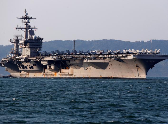 U.S. Navy aircraft carrier, USS Carl Vinson, docks at a port in Danang, Vietnam March 5, 2018. REUTERS/Kham