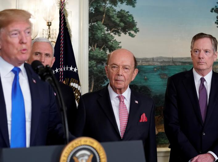 U.S. President Donald Trump, flanked by ?Vice President Mike Pence?, Commerce Secretary Wilbur Ross and U.S. Trade Representative Robert Lighthizer, delivers remarks before signing a memorandum on intellectual property tariffs on high-tech goods from Chin