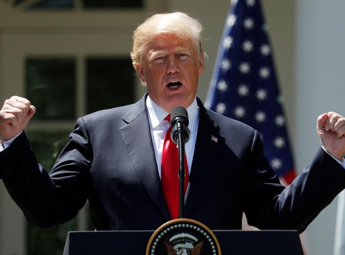 U.S. President Donald Trump gestures while addressing a joint news conference with Nigeria's President Muhammadu Buhari in the Rose Garden of the White House in Washington, U.S., April 30, 2018.