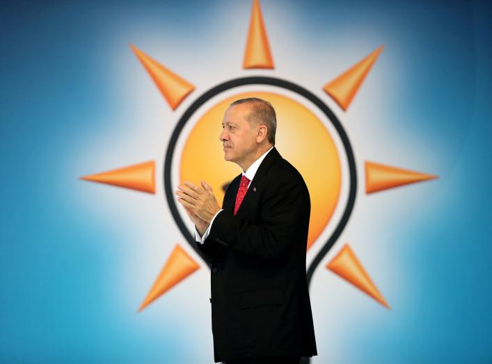Turkish President Tayyip Erdogan announces his ruling AK Party's manifesto for next month's election.