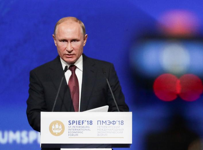 Russian President Vladimir Putin delivers a speech during a session of the St. Petersburg International Economic Forum (SPIEF), Russia May 25, 2018