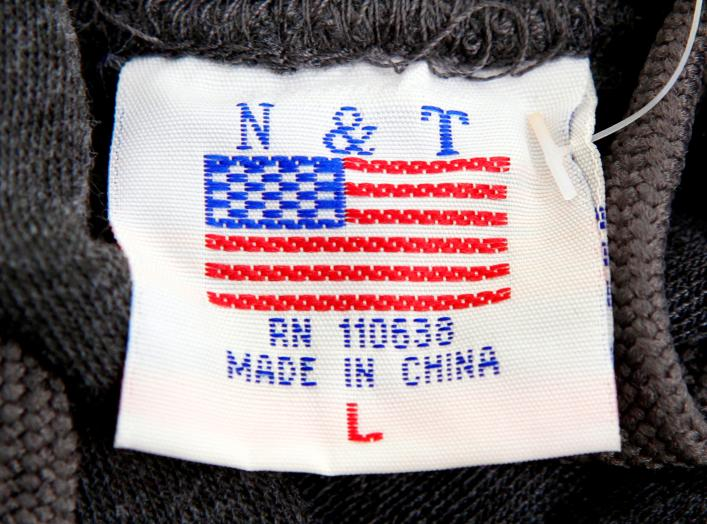 "The label of a Washington D.C. sweatshirt bears a U.S. flag but says ""Made in China"" at a souvenir stand in Washington, DC, U.S., January 14, 2011. REUTERS/Kevin Lamarque/File Photo"