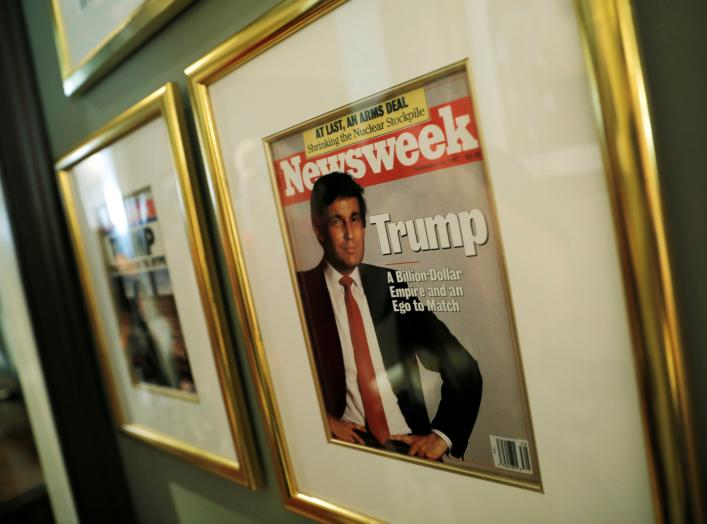 A framed Newsweek magazine cover of U.S. President Donald Trump hangs on the wall of the Trump National Golf Club Bedminster clubhouse in Berkeley Heights, New Jersey, U.S., August 9, 2018. REUTERS/Carlos Barria
