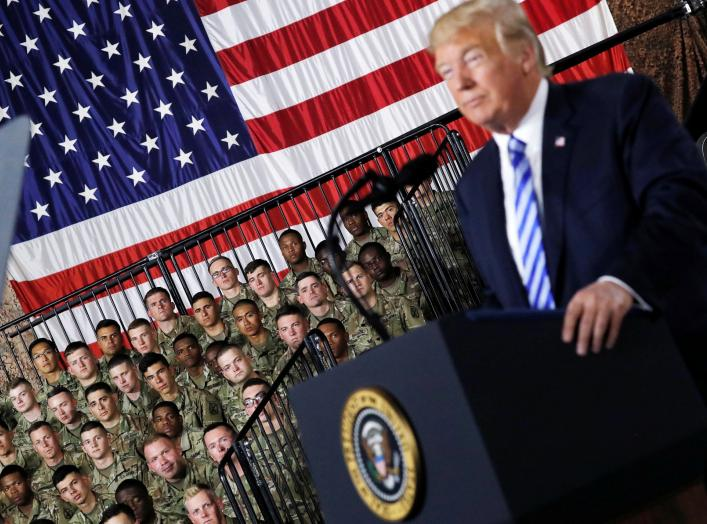 U.S. Army 10th Mountain Division troops listen as President Donald Trump speaks before signing the National Defense Authorization Act at Fort Drum, New York, U.S., August 13, 2018. REUTERS/Carlos Barria