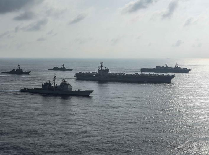 The Ronald Reagan Strike Group ship's the aircraft carrier USS Ronald Reagan (CVN 76), the guided-missile cruiser USS Antietam (CG 54) and the guided-missile destroyer USS Milius (DDG 69) conduct a photo exercise with the Japan Maritime Self-Defense Force