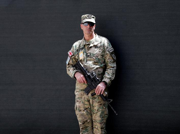 A member of NATO forces in Afghanistan, stands guard during a change of command ceremony in Resolute Support headquarters in Kabul, Afghanistan September 2, 2018. REUTERS/Mohammad Ismail