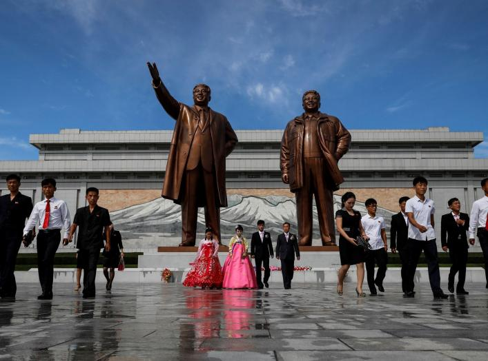 A couple with their friends and families leave after paying their respects in front of bronze statues of the late leaders Kim Il Sung and Kim Jong Il before getting married in Pyongyang, North Korea, September 11, 2018. REUTERS/Danish Siddiqui