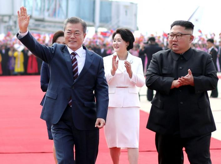 South Korean President Moon Jae-in and North Korean leader Kim Jong Un attend an official welcome ceremony at Pyongyang Sunan International Airport, in Pyongyang, North Korea, September 18, 2018. Pyeongyang Press Corps/Pool via REUTERS