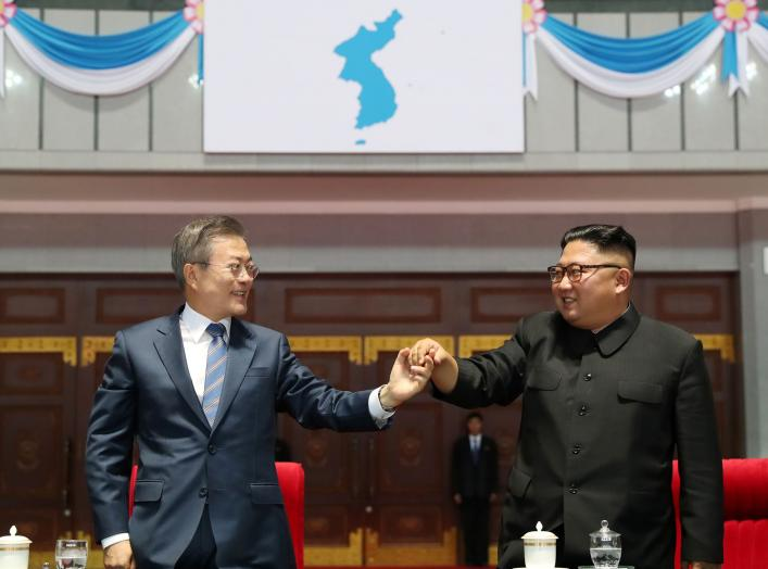 "South Korean President Moon Jae-in and North Korean leader Kim Jong Un hold hands after watching the performance titled ""the Glorious Country"" at the May Day Stadium in Pyongyang, North Korea, September 19, 2018. Pyeongyang Press Corps/Pool via REUTERS"