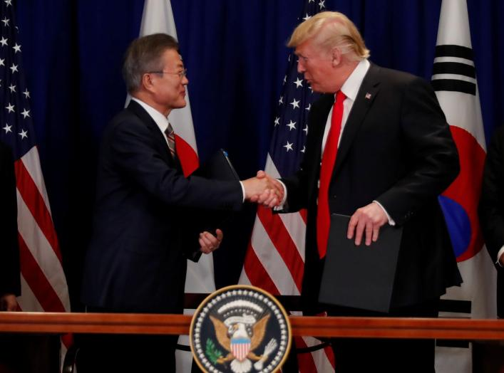 South Korean President Moon Jae-in shakes hands with U.S. President Donald Trump after they signed the U.S.-Korea Free Trade Agreement on the sidelines of the 73rd United Nations General Assembly in New York, U.S., September 24, 2018. REUTERS/Carlos Barri