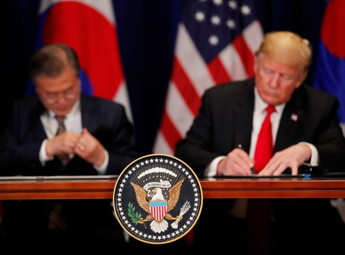 U.S. President Donald Trump and South Korean President Moon Jae-in sign the U.S.-Korea Free Trade Agreementon during a ceremony on the sidelines of the 73rd United Nations General Assembly in New York, U.S., September 24, 2018. REUTERS/Carlos Barria