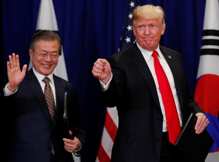 U.S. President Donald Trump and South Korean President Moon Jae-in gesture after signing the U.S.-Korea Free Trade Agreementon during a ceremony on the sidelines of the 73rd United Nations General Assembly in New York, U.S., September 24, 2018. REUTERS/Ca