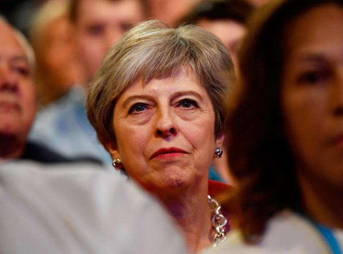 Britain's Prime Minister Theresa May sits in the audience at the start of the Conservative Party Conference in Birmingham, Britain September 30, 2018. REUTERS/Toby Melville