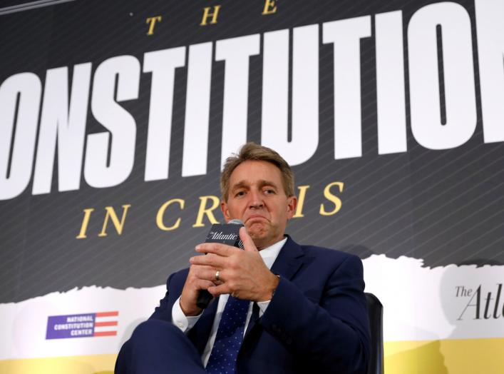 """U.S. Senator Jeff Flake (R-AZ) takes part in a discussion """"Can our Democracy Survive?"""" at The Atlantic and the Aspen Institute's 2018 Atlantic Festival in Washington, U.S., October 2, 2018. REUTERS/Kevin Lamarque TPX IMAGES OF THE DAY"""