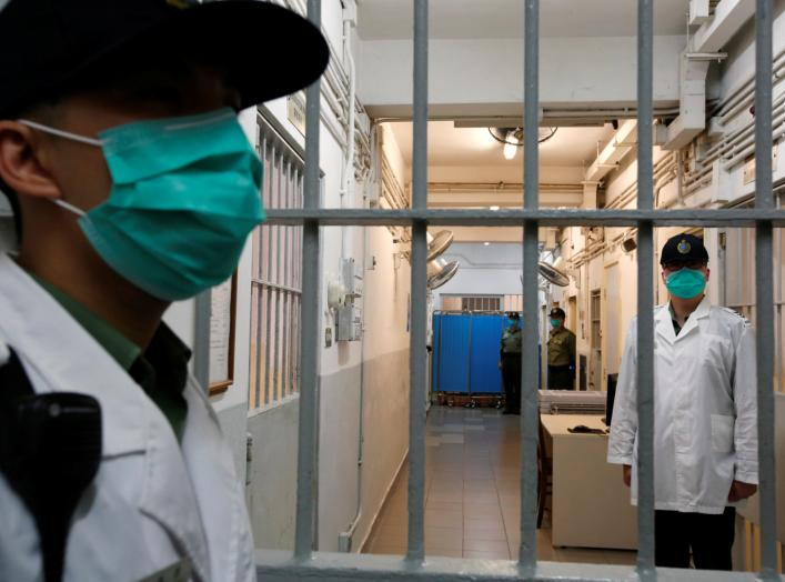 Correctional Services Department officers on patrol inside the special wards for drug tests and patients at Lai Chi Kok Reception Centre, a maximum security institution for detainees and judgement respited prisoners, in Hong Kong, China November 8, 2018.