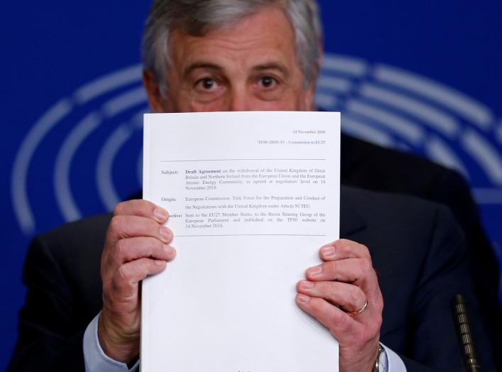 European Parliament President Antonio Tajani displays withdrawal agreement at a news conference about Brexit at the European Parliament in Strasbourg, France, November 15, 2018. REUTERS/Vincent Kessler