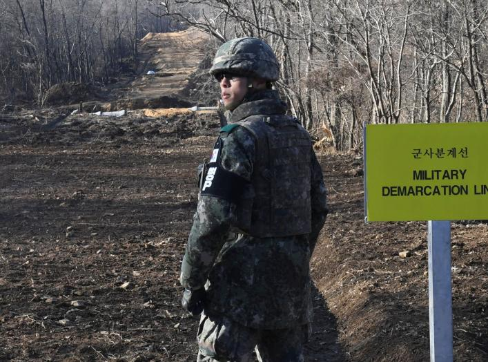 A South Korean soldier stands at the Arrowhead ridge, a site of fierce battles in the 1950-53 Korean War, to build a tactical road across the Military Demarcation Line inside the Demilitarized Zone (DMZ), in the central section of the inter-Korean border