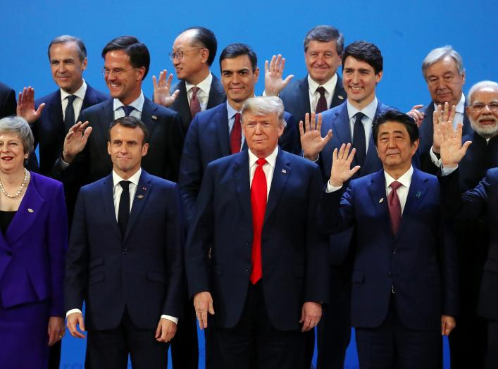 Britain's Prime Minister Theresa May, French President Emmanuel Macron, U.S. President Donald Trump, Japanese Prime Minister Shinzo Abe, Argentina's President Mauricio Macri and G20 leaders pose for a family photo during the G20 summit in Buenos Aires, Ar