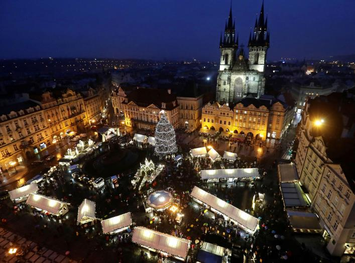 A Christmas tree is illuminated as people visit the traditional Christmas market at the Old Town Square in Prague, Czech Republic, December 2, 2018. REUTERS/David W Cerny