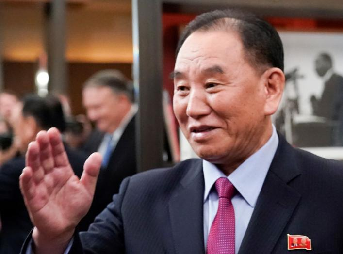 Vice Chairman of the North Korean Workers' Party Committee Kim Yong Chol, North Korea's lead negotiator in nuclear diplomacy with the United States, waves as he meets with U.S. Secretary of State Mike Pompeo (reflected in background 2ndL) for talks aimed