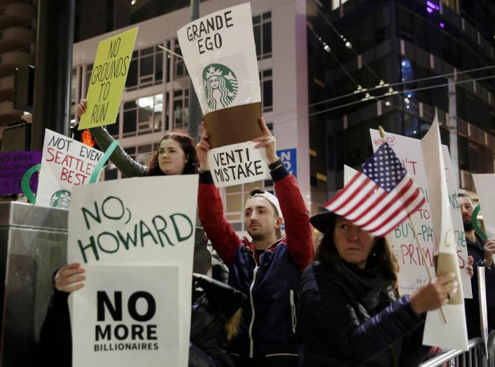 People protest outside before former Starbucks CEO Howard Schultz speaks during his book tour in Seattle, Washington, U.S., January 31, 2019. REUTERS/Jason Redmond