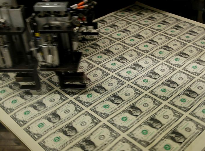 FILE PHOTO: United States one dollar bills get rotated before being cut into individual pieces during production at the Bureau of Engraving and Printing in Washington November 14, 2014. REUTERS/Gary Cameron/File Photo