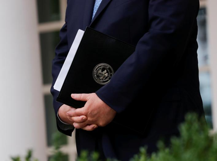 U.S. Attorney General Bill Barr stands with a copy of his remarks in his hands before announcing the Trump administration's effort to gain citizenship data during the 2020 census at an event with the president in the Rose Garden of the White House
