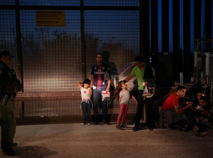 Migrant families from Honduras turn themselves to U.S. Border Patrol to seek asylum following an illegal crossing of the Rio Grande in Hidalgo, Texas, U.S., August 23, 2019. Picture taken August 23, 2019. REUTERS/Loren Elliott