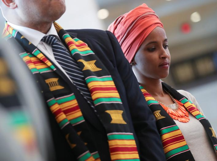 "U.S. Rep. Ilhan Omar (D-MN) participates in a Congressional Black Caucus ceremony ""in commemoration of the 400th anniversary of the first-recorded forced arrival of enslaved African people"" to the United States in Emancipation Hall at the U.S. Capitol"