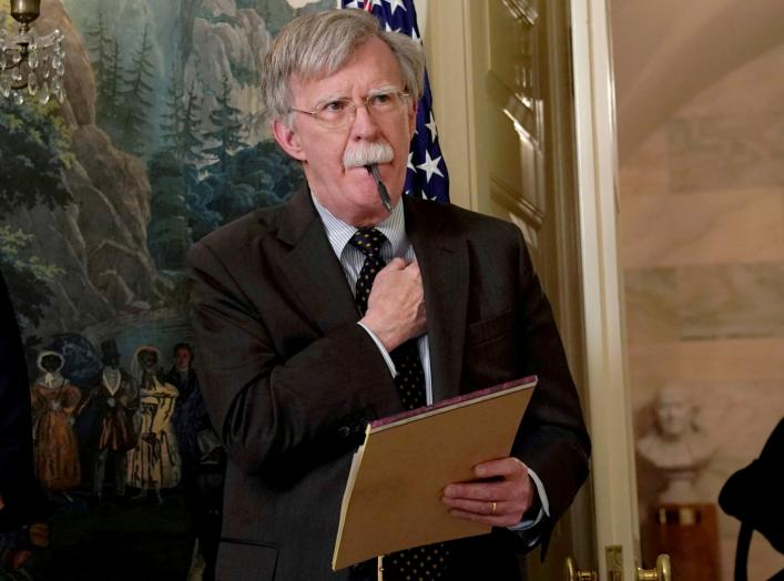 FILE PHOTO: National Security Adviser John Bolton listens to U.S. President Donald Trump's statement on Syria at the White House in Washington, U.S., April 13, 2018. Picture taken April 13, 2018. REUTERS/Yuri Gripas/File Photo
