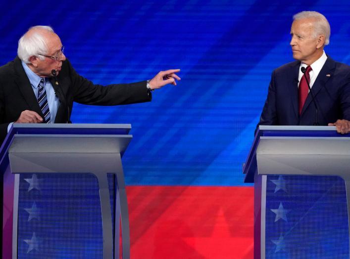 Senator Bernie Sanders gestures towards former Vice President Joe Biden (R) as he speaks during the 2020 Democratic U.S. presidential debate in Houston, Texas, U.S. September 12, 2019. REUTERS/Mike Blake