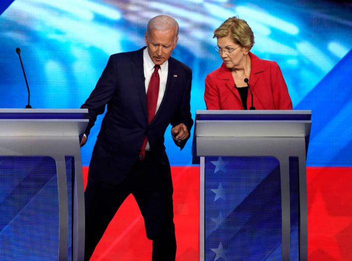 Former Vice President Joe Biden talks with Senator Elizabeth Warren during a break at the 2020 Democratic U.S. presidential debate in Houston, Texas, U.S. September 12, 2019. REUTERS/Mike Blake
