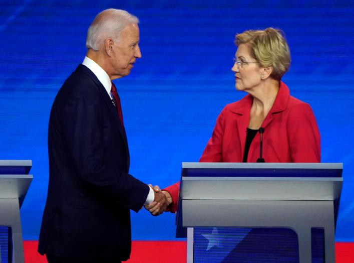 Former Vice President Joe Biden shake hands with Senator Elizabeth Warren at the conclusion of the 2020 Democratic U.S. presidential debate in Houston, Texas, U.S., September 12, 2019. REUTERS/Mike Blake