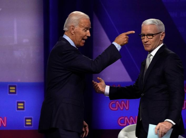 Democratic 2020 U.S. presidential candidate and former Vice President Joe Biden reacts next to moderator CNN's Anderson Cooper during a televised townhall on CNN dedicated to LGBTQ issues in Los Angeles, California, U.S. October 10, 2019. REUTERS/Mike Bla