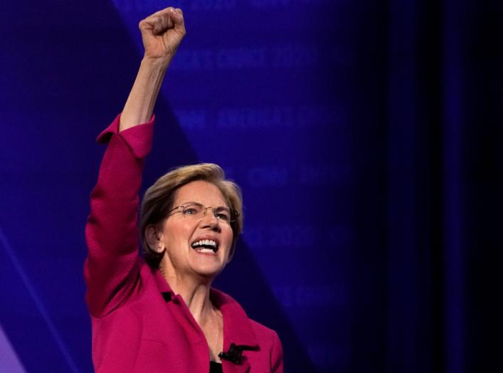 FILE PHOTO: Democratic 2020 U.S. presidential candidate Senator Elizabeth Warren (D-MA) gestures in a televised townhall on CNN dedicated to LGBTQ issues in Los Angeles, California, U.S. October 10, 2019. REUTERS/Mike Blake/File Photo