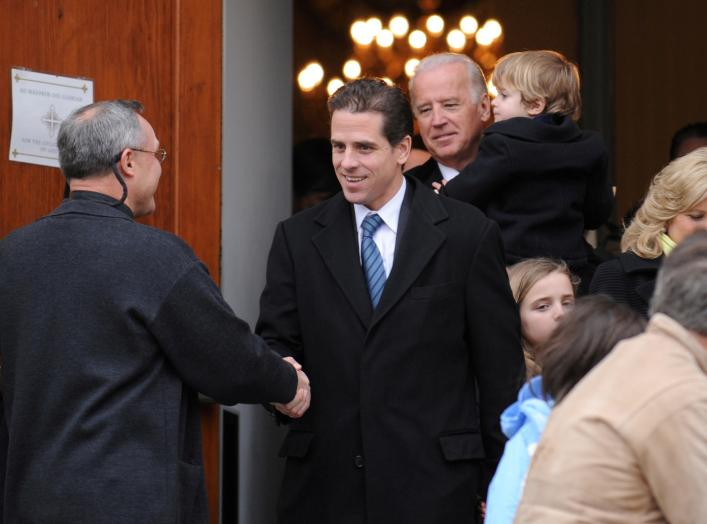 FILE PHOTO: U.S. Vice President Joe Biden and his son Hunter Biden depart after a pre-inauguration church service in Washington, U.S., January 18, 2009. REUTERS/Jonathan Ernst/File Photo