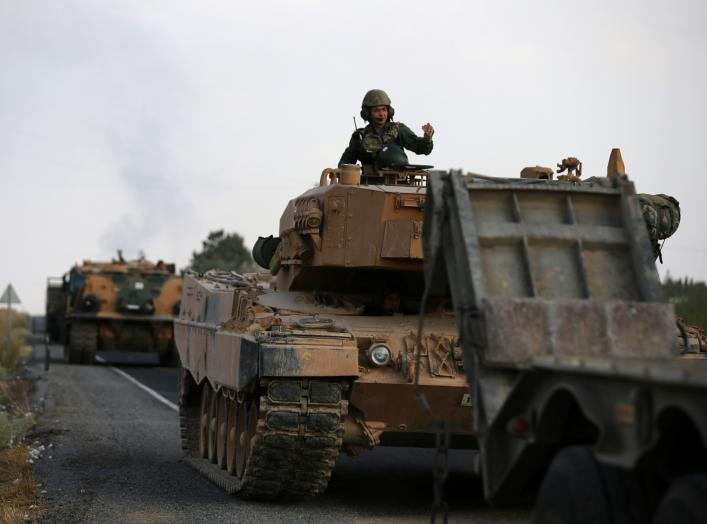Turkish army vehicles are moving on a road near the Turkish border town of Ceylanpinar, Sanliurfa province, Turkey, October 18, 2019. REUTERS/Stoyan Nenov