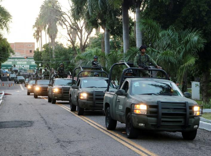 Members of a special unit of the Mexican Army leave a military zone to patrol as part of an operation to increase security after cartel gunmen clashed with federal forces, resulting in the release of Ovidio Guzman from detention, the son of drug kingpin