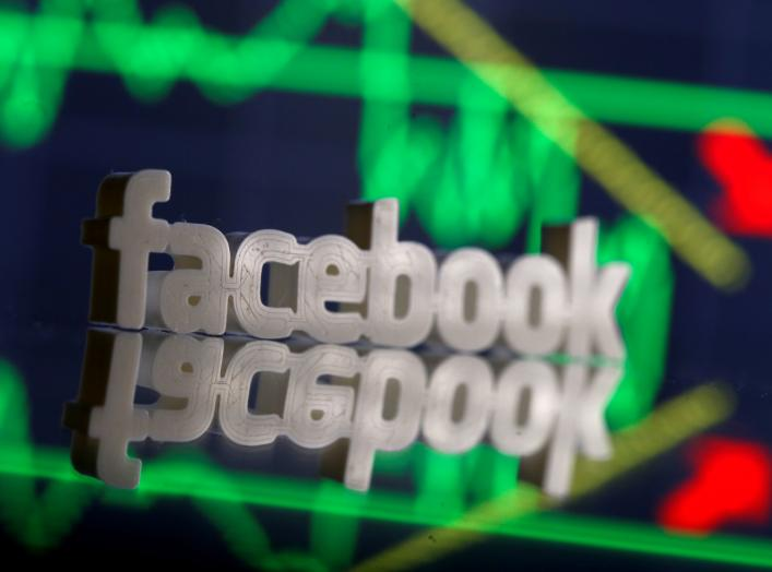 A 3D-printed Facebook logo is seen in front of displayed stock graph in this illustration photo, March 20, 2018. Picture taken March 20. REUTERS/Dado Ruvic