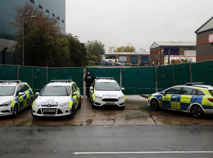 Police vehicles are seen at the scene where bodies were discovered in a lorry container, in Grays, Essex, Britain October 24, 2019. REUTERS/Simon Dawson
