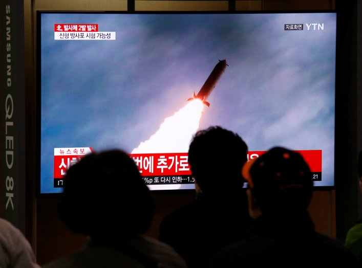 People watch a TV broadcast showing a file footage for a news report on North Korea firing two projectiles, possibly missiles, into the sea between the Korean peninsula and Japan, in Seoul, South Korea, October 31, 2019. REUTERS/Heo Ran