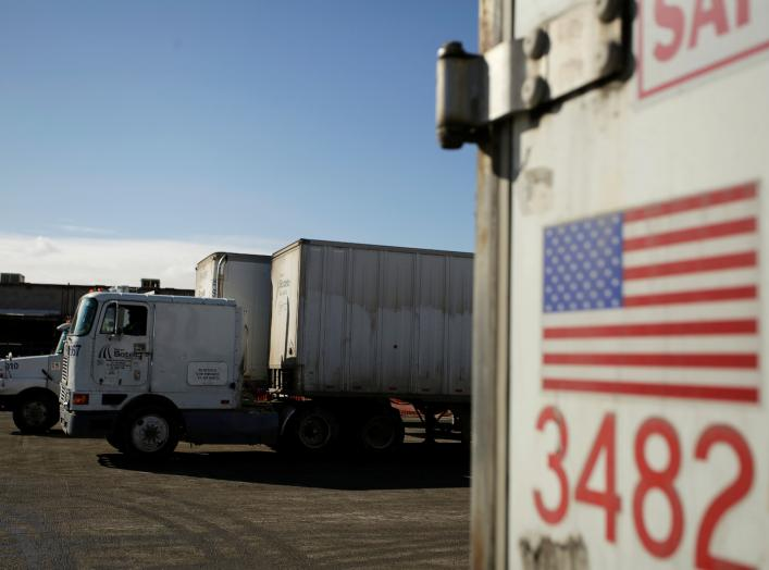 A U.S. flag is pictured on a truck loaded with merchandise at the freight shipping company Sotelo, which transports goods between Mexico and the United States, in Ciudad Juarez, Mexico, December 10, 2019. REUTERS/Jose Luis Gonzalez