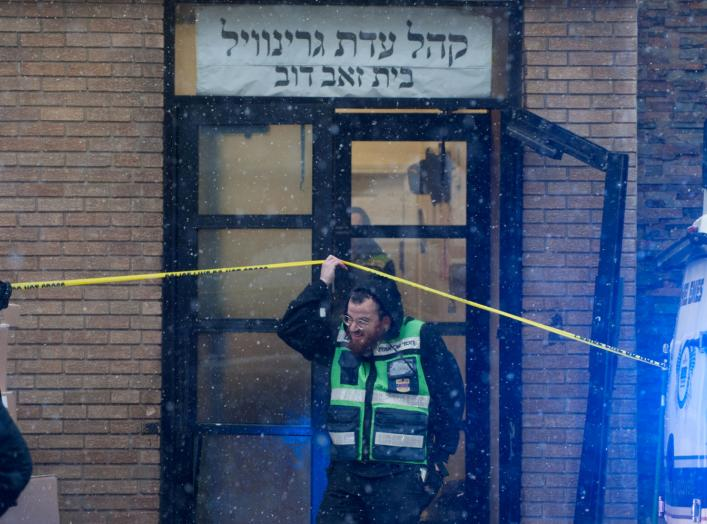 Emergency personnel and investigators work at the scene the day after an hours-long gun battle with two men around a kosher market in Jersey City, New Jersey, U.S., December 11, 2019. REUTERS/Lloyd Mitchell TPX IMAGES OF THE DAY