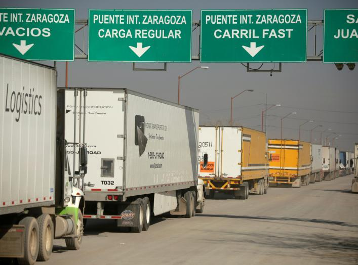 Trucks wait in a queue for border customs control, to cross into the U.S., at the Zaragoza-Ysleta border crossing bridge in Ciudad Juarez, Mexico December 12, 2019. REUTERS/Jose Luis Gonzalez