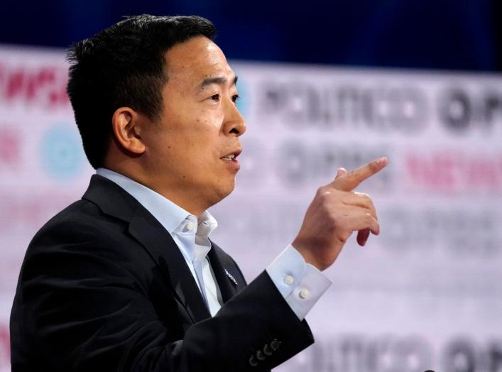 Democratic U.S. presidential candidate entrepreneur Andrew Yang speaks at the 2020 campaign debate at Loyola Marymount University in Los Angeles, California, U.S., December 19, 2019. REUTERS/Mike Blake
