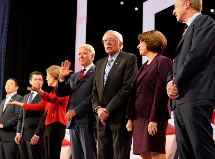 Former Vice President Joe Biden waves from among the seven Democratic presidential candidates...during the sixth 2020 U.S. Democratic presidential candidates campaign debate at Loyola Marymount University in Los Angeles, California, U.S.