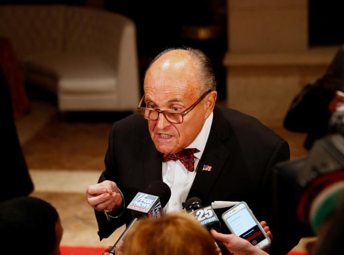 U.S. President Donald Trump's personal lawyer Rudy Giuliani is interviewed by the press at the Mar-a-Lago resort in Palm Beach, Florida, U.S. December 31, 2019. REUTERS/Tom Brenner
