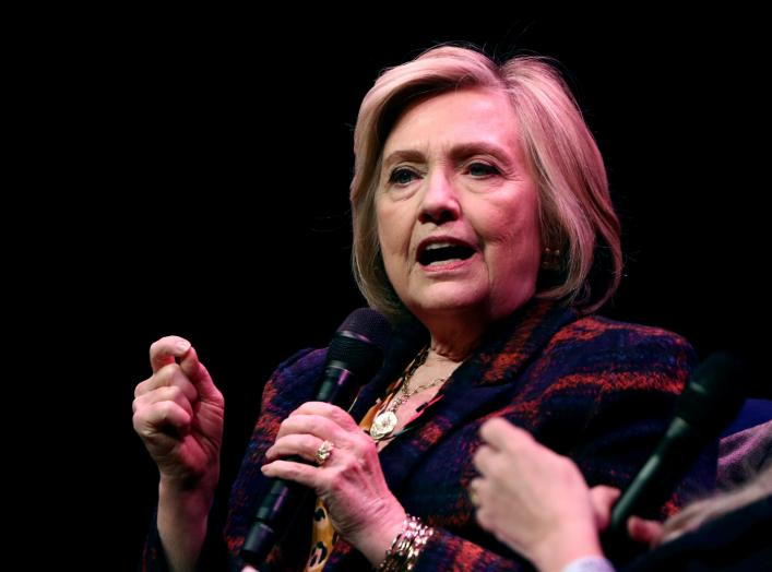 "FILE PHOTO: Former U.S. Secretary of State Hillary Clinton speaks during an event promoting ""The Book of Gutsy Women"" at the Southbank Centre in London, Britain, November 10, 2019. REUTERS/Simon Dawson/File Photo"